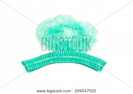 green medical disposable cap before and after use on white background