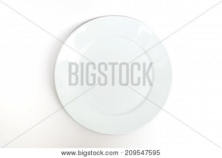 empty new ceramics plate isolated on white background - top view