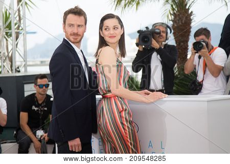 CANNES, FRANCE - MAY 23, 2015: Marion Cotillard, Michael Fassbender attend the 'Macbeth' Photocall . 68th annual Cannes Film Festival at the Palais des Festivals