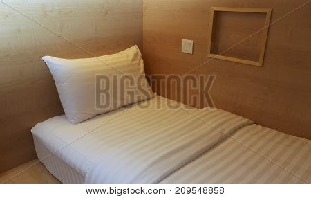 Bed In Small Simple Hotel Bedroom