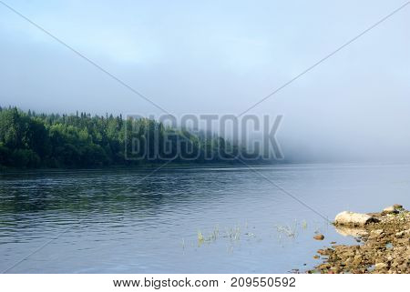 morning mist over the Ural river Vishera view from the shore. the shore in the background is lost in the haze poster