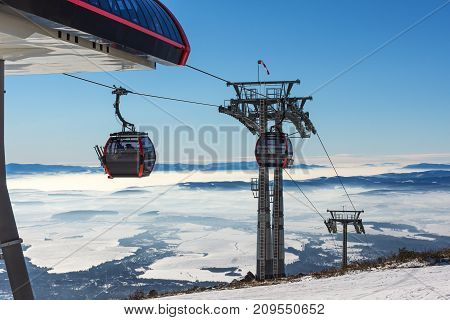 Ski resort. Gondola lift. Cabin of ski-lift in the ski resort.