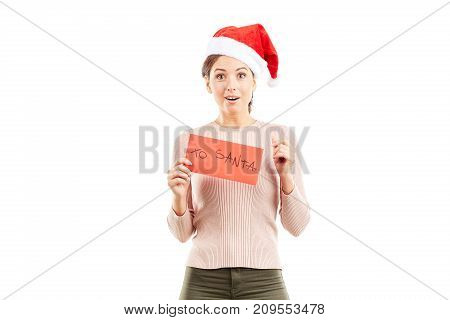 Portrait of woman in Santa hat holding envelope with letter to Santa