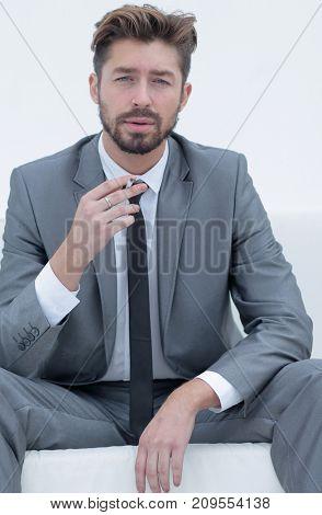 Portrait of a businessman in a suit with a cigarette