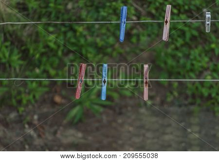 Collection of several plastic clothespins background close