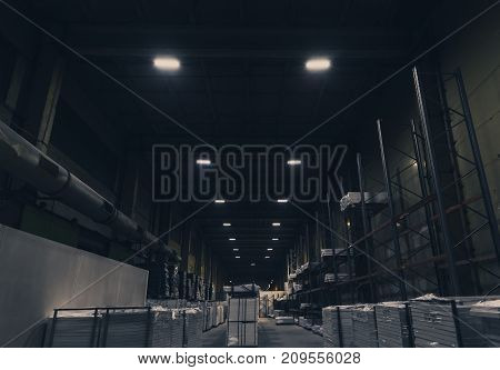 Big warehouse with packed ready goods on high shelves. Special toned photo
