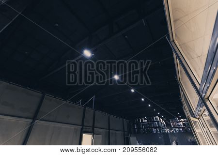 Big warehouse with packed ready goods on high shelves. Special toned photo. View from below