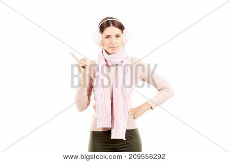 Portrait of young woman wearing winter earmuffs and scarf