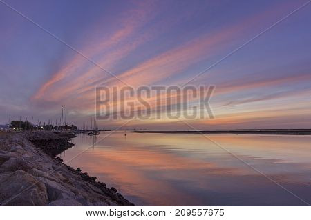Dawn seascape view of Olhao Marina waterfront to Ria Formosa natural park. Algarve. Portugal.