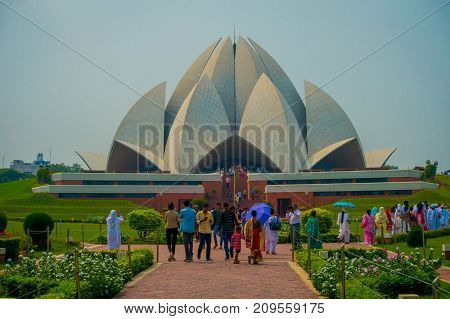 Delhi, India - September 27, 2017: Crowd of people walking and enjoying the beautiful Lotus Temple, located in New Delhi, India, is a Bahai House of Worship.