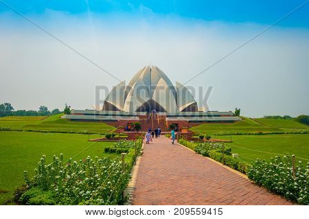 Delhi, India - September 27, 2017: Unidentified people walking and enjoying the beautiful Lotus Temple, located in New Delhi, India, is a Bahai House of Worship.
