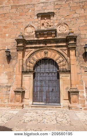 Ornate Ancient Door Of Church San Mateo In Banos De La Encina Village