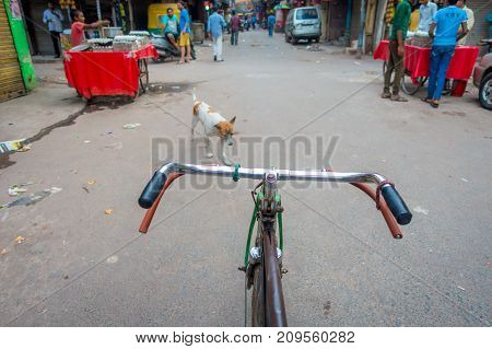 Delhi, India - September 25, 2017: Close up of a a bike parked in the streets in Paharganj Delhi with muslim shoppers.