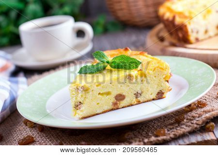 Appetizing cottage cheese casserole with raisins close up