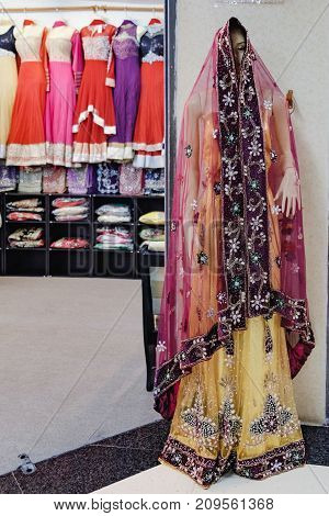 Bangkok, Thailand - January 30, 2016: Traditional Indian women's clothing for sale at the street market in Chinatown district, Bangkok, Thailand. Mannequin in colorful beautiful clothes
