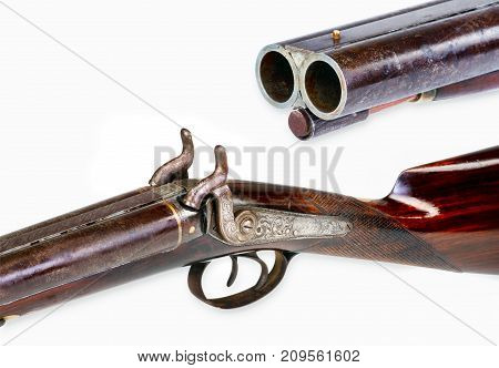 Antique double barrel shotgun with room for your type.