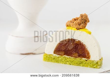 Cut Vanilla Mousse Pastry Dessert With Caramelized Pear