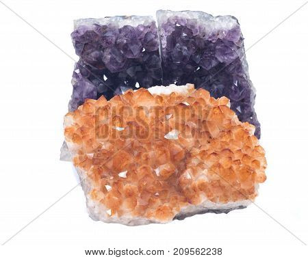 Citrine druzy cluster surrounded by amethyst druzy clusters  isolated on white background