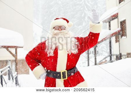Santa Claus on snow in winter at Christmas.