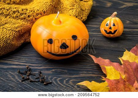 Halloween holiday with pumpkin candle wool and clove