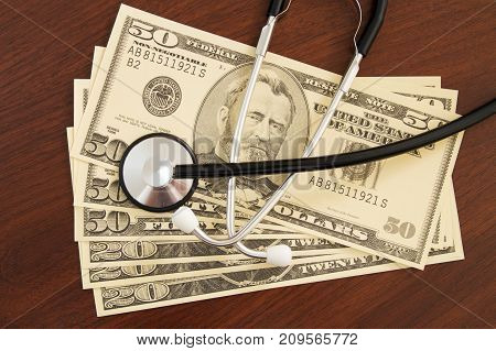 US currency with a stethoscope concept image.
