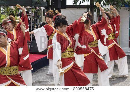 Tokyo, Japan - September 24 2017: Smiling Dancers In Traditional Clothing Perfoming Japananese Dance