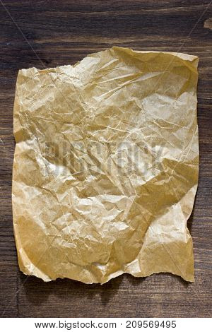 List of parchment paper on brown wooden board