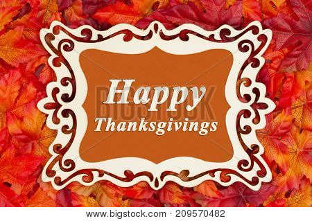 Happy Thanksgiving greeting fancy wood frame and fall leaves