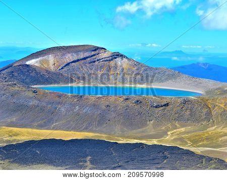 blue lake between montains. Tongariro, New Zealand