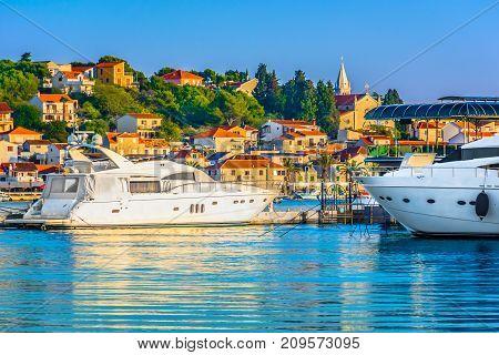 Seafront view at marble Adriatic Sea in Rogoznica tourist resort, popular coastal town in Croatia, Mediterranean.