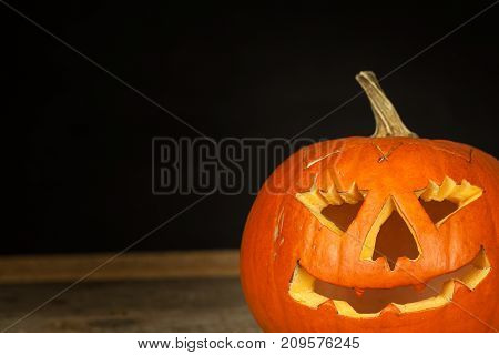 Detail of carved pumpkin. Halloween Celebration. Traditional decoration of the pumpkin