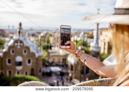 Photographing with phone Guell park in Barcelona city