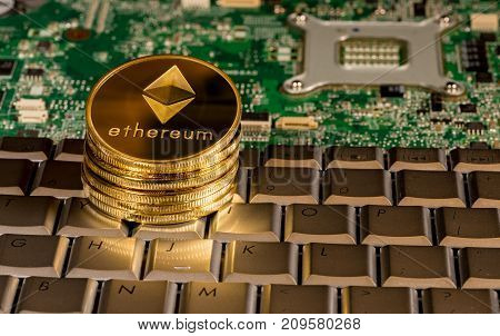 Ethereum coin on a keyboard with computer board to illustrate blockchain and cyber currency
