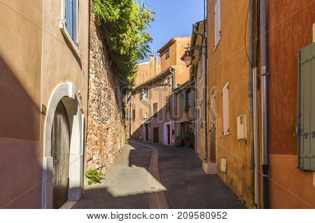 Colorful red streets of Roussillon village. France