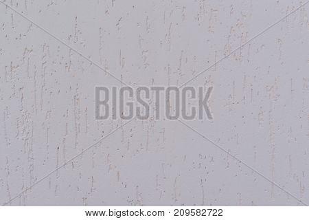 Plain grey wall with cross texture closeup