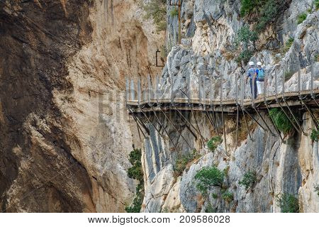 Long shot of King's Little Path footpath across vertical wall with tourists walking, one of the most Dangerous in the world