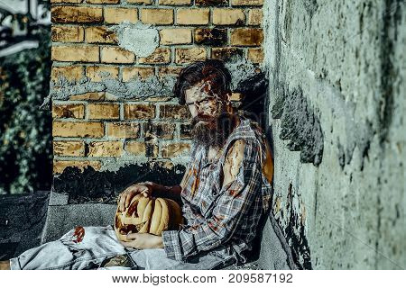 Halloween Man And Pumpkin On Grunge Wall