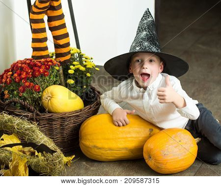 Halloween Small Boy In Spider Web Hat At Striped Socks.