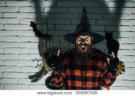 Halloween Man Giving Double Middle Finger Gestures In Dark Shadow.