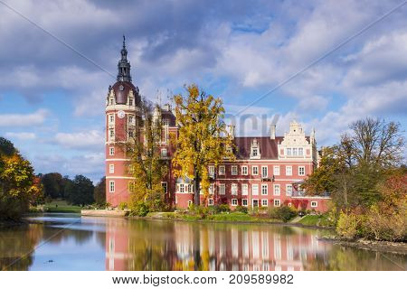 Castle in Bad Muskau with reflection in the Lake