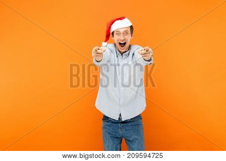 Hey You! New Year Is Coming! Attractive Man Pointing Finger At Camera, And Toothy Smiling.