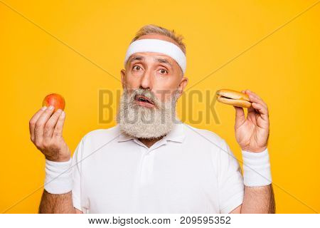 Athlete Cool Uncertain Unsure Ponder Fit Picky Grandpa Holds Forbidden Cheeseburger And Fruit, Decid