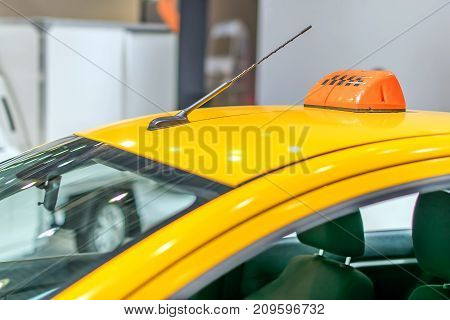 yellow taxi roof with a checker and an antenna.