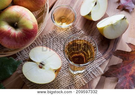 Apple Cider Vinegar In A Glass, With Apples In The Background
