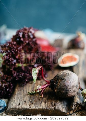 Organic Beetroot. Dark Red Beetroot on Wooden Cutting Board
