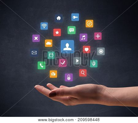 Colorful applications hovering over young hand