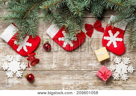 Fir tree branches and Christmas decorations are on the boards. Christmas background. Christmas Socks. New Year background. Xmax background. Christmas tree.