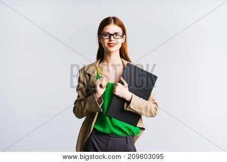 girl secretary in glasses holds a file in hands on a white background