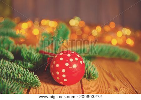 Christmas card. Background on a theme of New Year's  party. Decorated fir-tree with gifts and candles on the background of colorful festive lights. A magical evening.