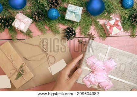 Christmas Holiday Decor. Border Decorated Blue Balls Or Bauble And Gift Boxes Wrapped Craft Paper,